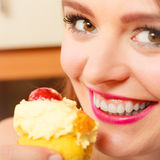 Woman eating delicious sweet cake. Gluttony. Stock Images