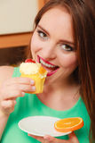 Woman eating delicious sweet cake. Gluttony. Stock Image