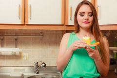 Woman eating delicious sweet cake. Gluttony. Royalty Free Stock Images