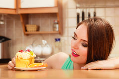 Woman eating delicious sweet cake. Gluttony. Royalty Free Stock Photography