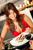 Woman eating a dessert Royalty Free Stock Photography