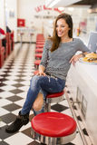 Woman eating in diner Stock Image