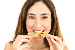 Woman eating energy bar Stock Images