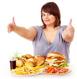 Woman eating fast food. Stock Photography