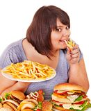 Woman eating fast food. Overweight woman eating fast food Royalty Free Stock Photos