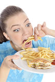 Woman eating fast food Stock Photography