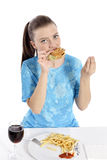Woman eating fast food Royalty Free Stock Photography
