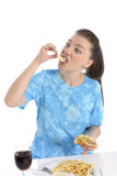 Woman eating fast food Royalty Free Stock Images