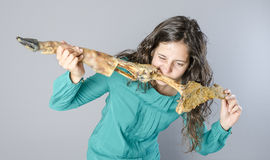 Woman eating a finished ham leg, making funny face Royalty Free Stock Photos