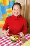 Woman eating fish Royalty Free Stock Photo