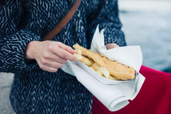 Woman eating fish and chips Stock Photography