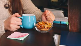 Woman eating food at work, lunch break at workplace in office stock footage
