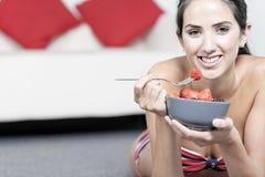 Woman eating fresh fruit Stock Photography