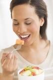 Woman Eating Fresh Fruit Salad At Home Royalty Free Stock Image