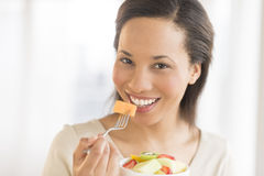 Woman Eating Fresh Fruit Salad At Home Stock Images