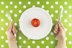 Woman eating fresh red tomato, top view Royalty Free Stock Images