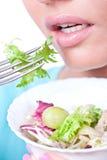 Woman eating fresh salad Royalty Free Stock Images
