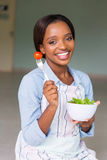 Woman eating fresh salad Stock Images