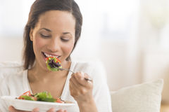 Woman Eating Fresh Salad At Home Stock Image