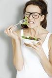 Woman eating fresh salad Royalty Free Stock Photo