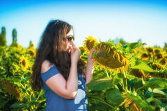 Woman eating fresh seeds of sunflower Stock Photography