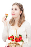 Woman eating fresh strawberries Stock Photo
