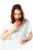 Woman eating fresh strawberry cake Royalty Free Stock Images