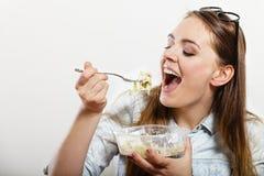 Woman eating fresh vegetable salad. Stock Photos