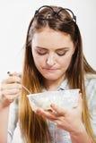 Woman eating fresh vegetable salad. Royalty Free Stock Image