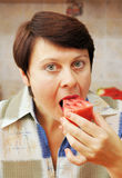 Woman is eating fresh watermelon Stock Photos