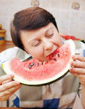 Woman is eating fresh watermelon Royalty Free Stock Photography