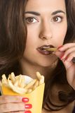 Woman Eating Fries stock images
