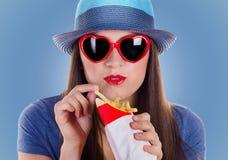 Woman eating fries potatoes Royalty Free Stock Photos