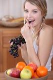 Woman eating fruit Royalty Free Stock Photo