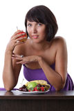 Woman eating fruit and berries Stock Images