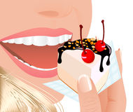 Woman eating fruit cake Royalty Free Stock Image