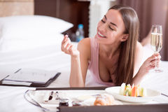 Woman eating fruit in the hotel Royalty Free Stock Photo