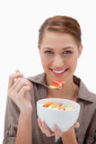 Woman eating fruit salad Stock Images