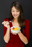 Woman eating a fruit salad Royalty Free Stock Photos