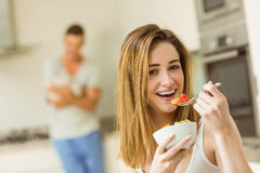 Woman eating fruit salad at breakfast Stock Photo