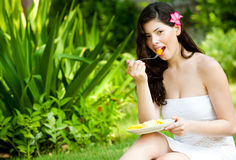 Woman Eating Fruits stock photo