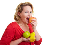 Woman eating fruits Royalty Free Stock Images