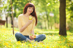 Woman eating fruits in the park Stock Images