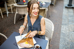 Woman eating galette meal at the restaurant in France Stock Image
