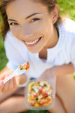 Woman eating gluten free pasta salad Stock Photography