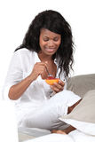 Woman eating grapefruit Stock Image