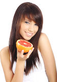 Woman eating grapefruit Royalty Free Stock Images