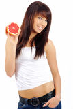 Woman eating grapefruit Stock Photo
