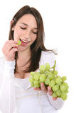 Woman Eating Grapes Stock Photo