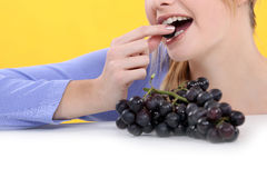 Woman eating grapes Royalty Free Stock Photo